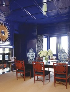 Carolyn Roehm loves blue and white and has even written a  book on the subject.  These high lacquer walls somehow work counterbalanced with bold urns, mirror and scale of room.